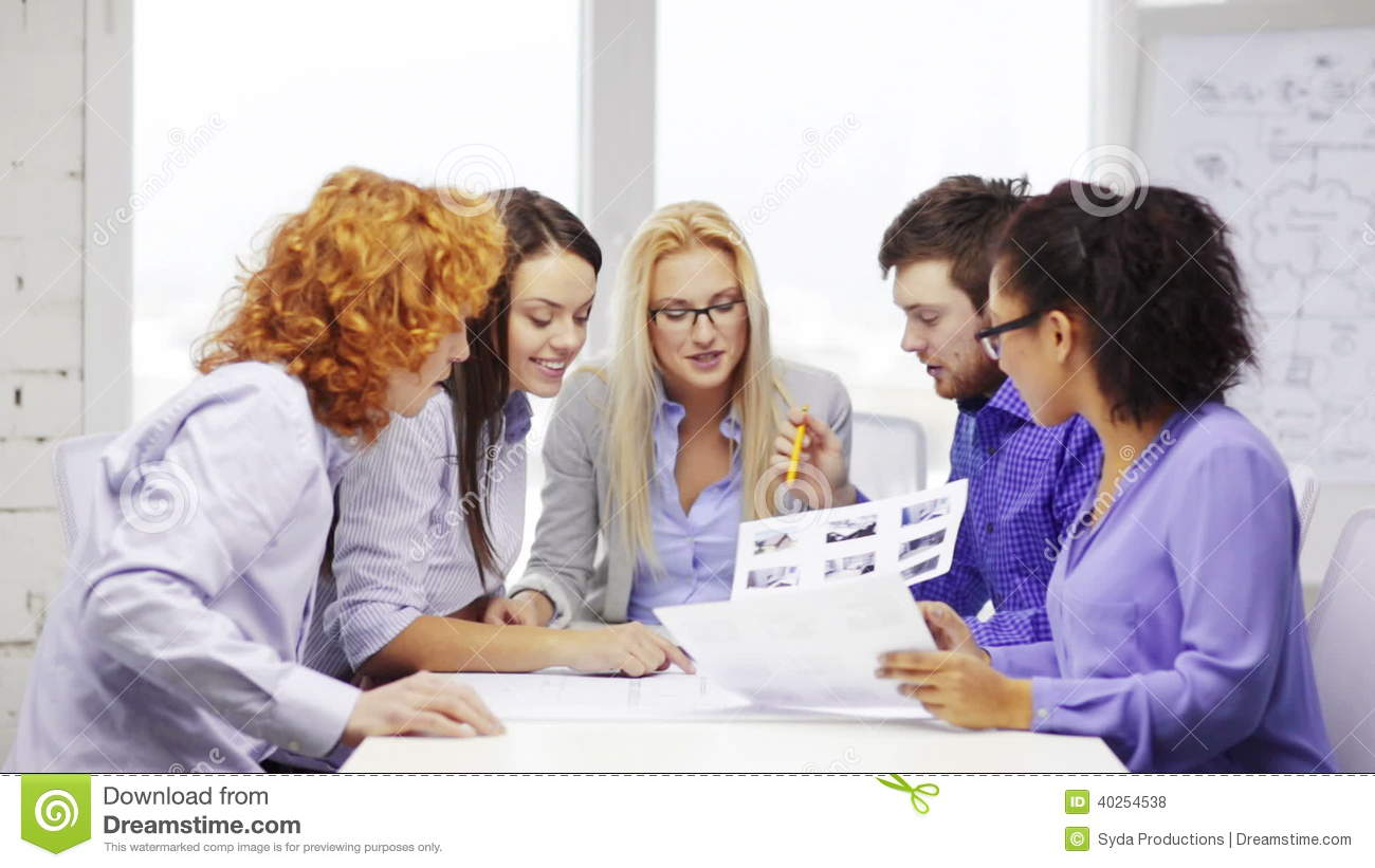 Team With Blueprint And Wallpaper Sample At Office Stock Footage