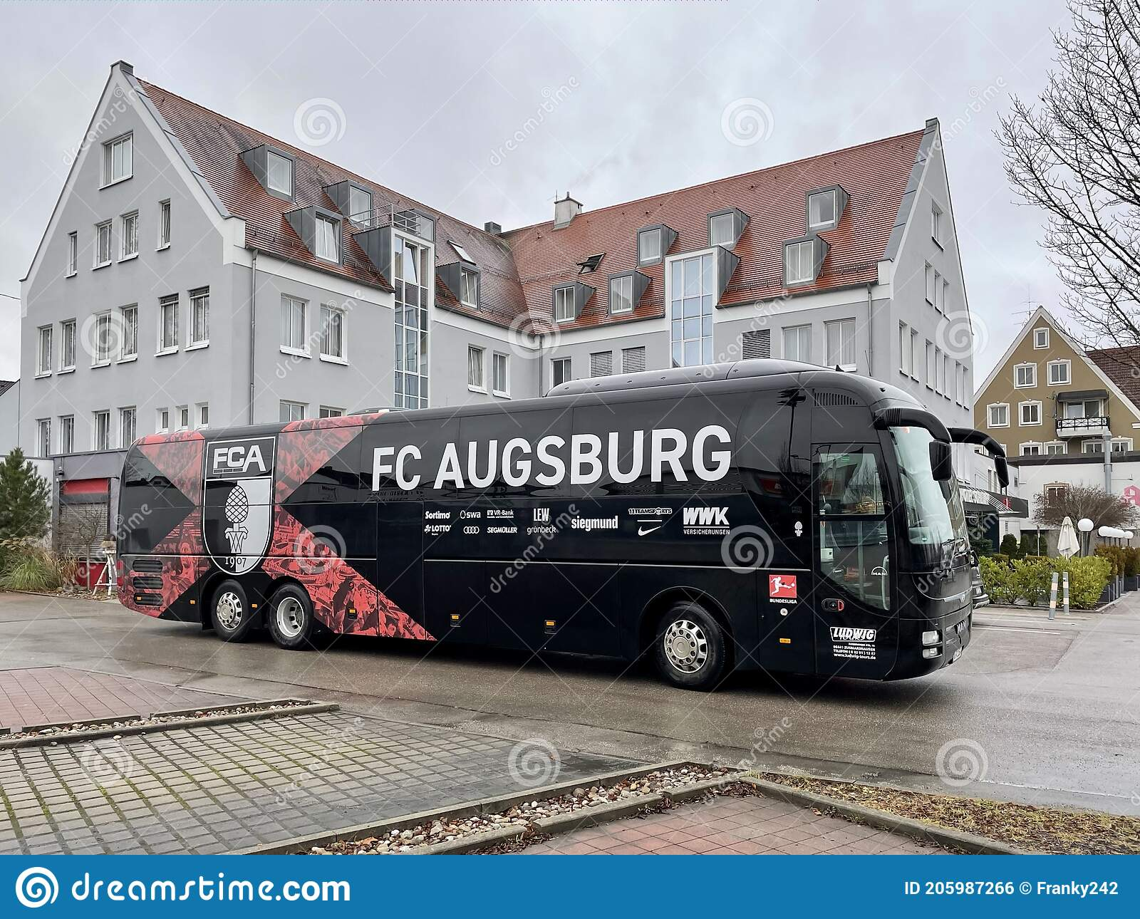 The Team Bus Of Football Club FC Augsburg Is Waiting In Front Of ...