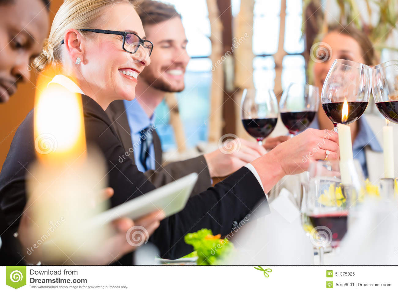 Team At Business Lunch Meeting In Restaurant Stock Photo ...