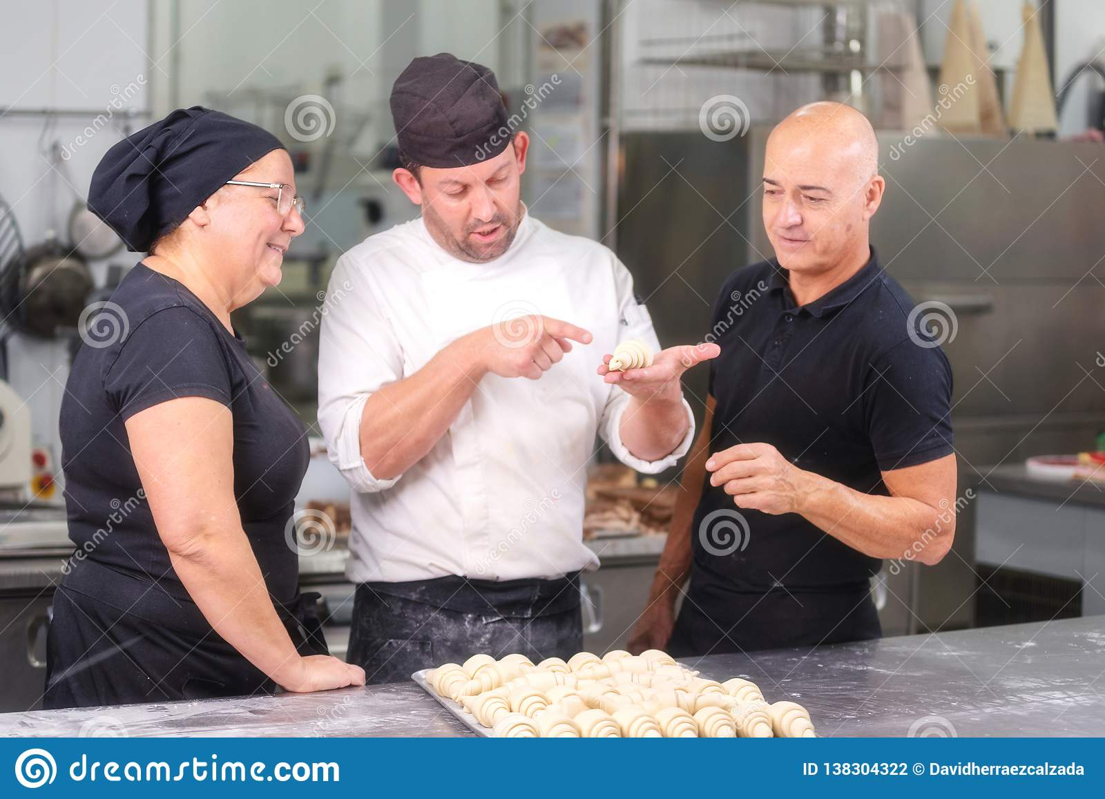Team of Confectioners talking about the croissant recipe