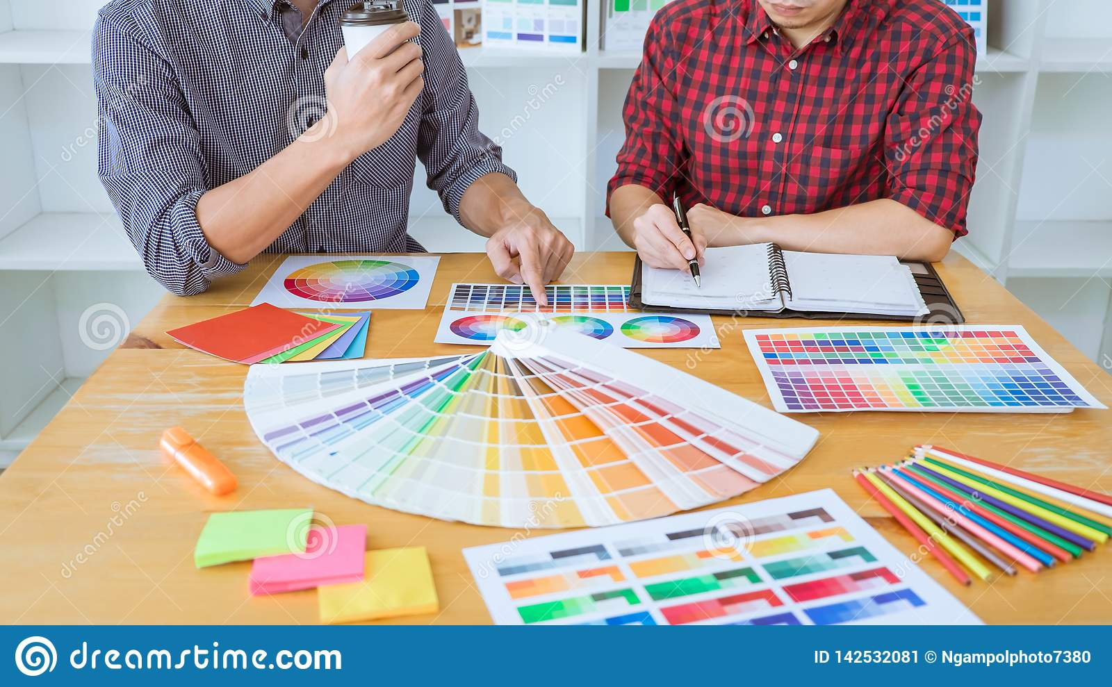 Team of Creative graphic designer meeting working on new project, choose selection color and drawing on graphics tablet with work
