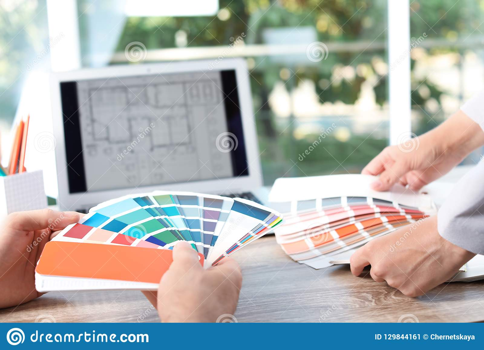Team of designers working with color palettes