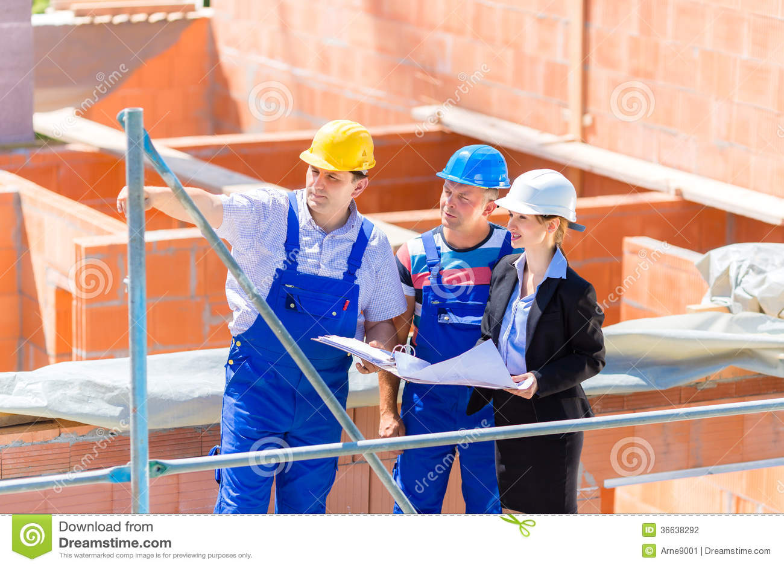 Team Discussing Construction Building Site Plans Stock