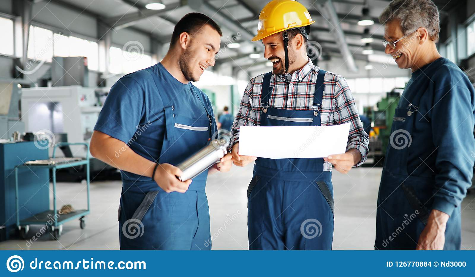 Team Of Engineers Having Discussion In Factory. Team Of Engineers Having Discussion In Metal Industries Factory Stock Images