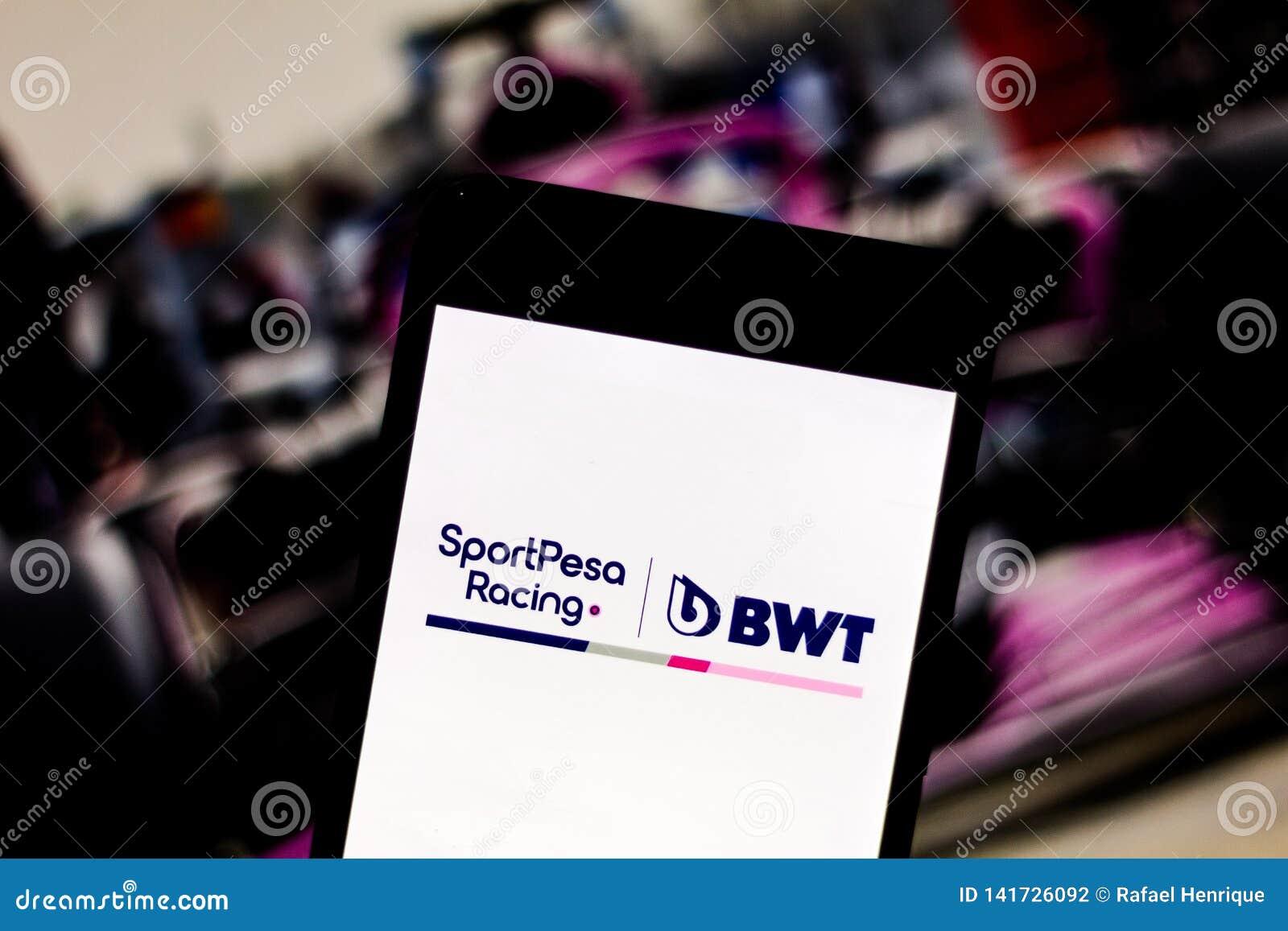 Team Formula 1 het Rennen embleem van het Puntf1 Team op het mobiele apparatenscherm Het rennen het Punt betwist het kampioenscha