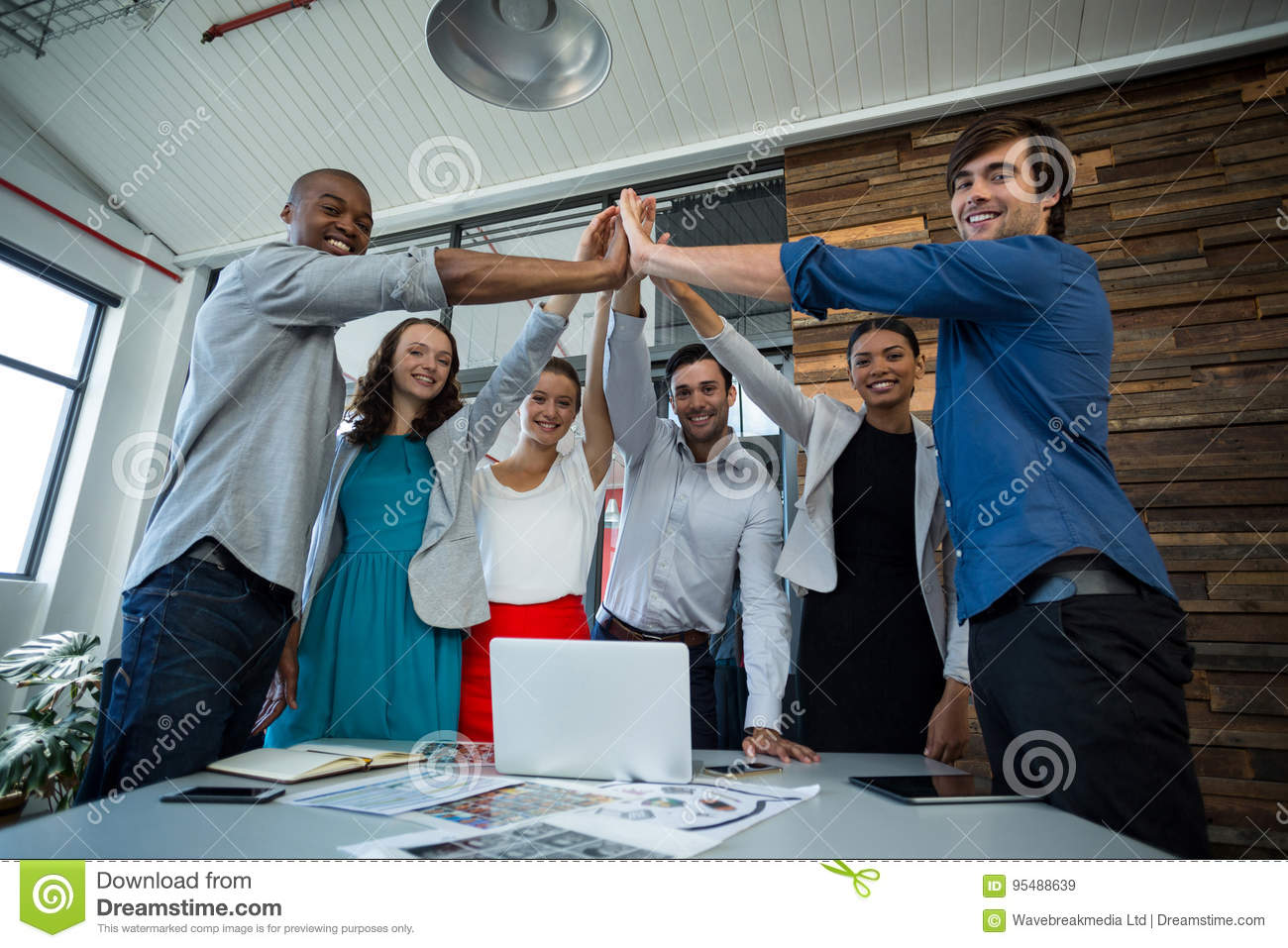 Team Of Graphic Designers Giving High Five To Each Other Stock Image
