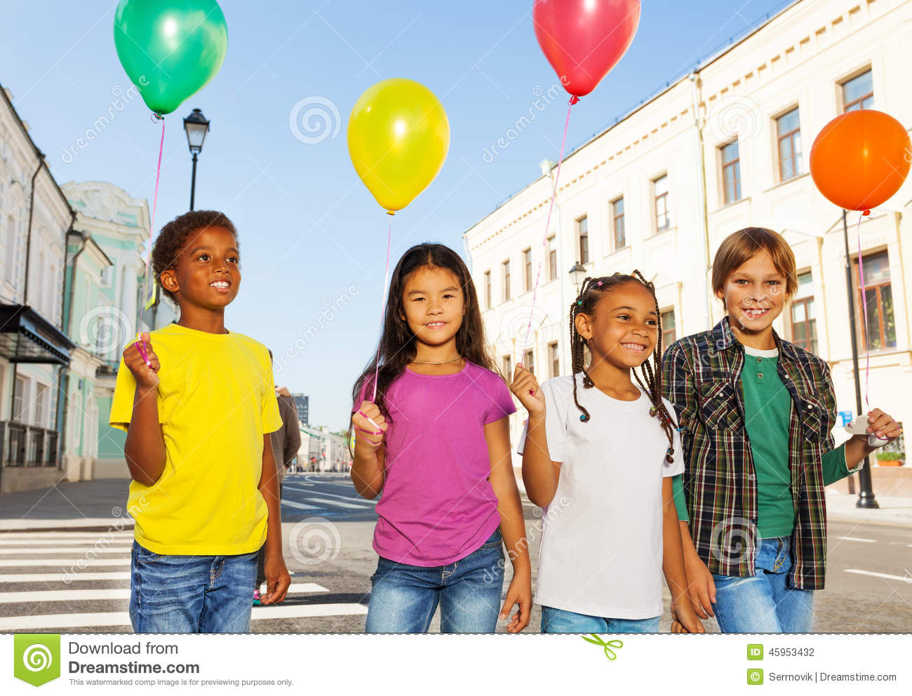 Team of kids with colorful balloons standing