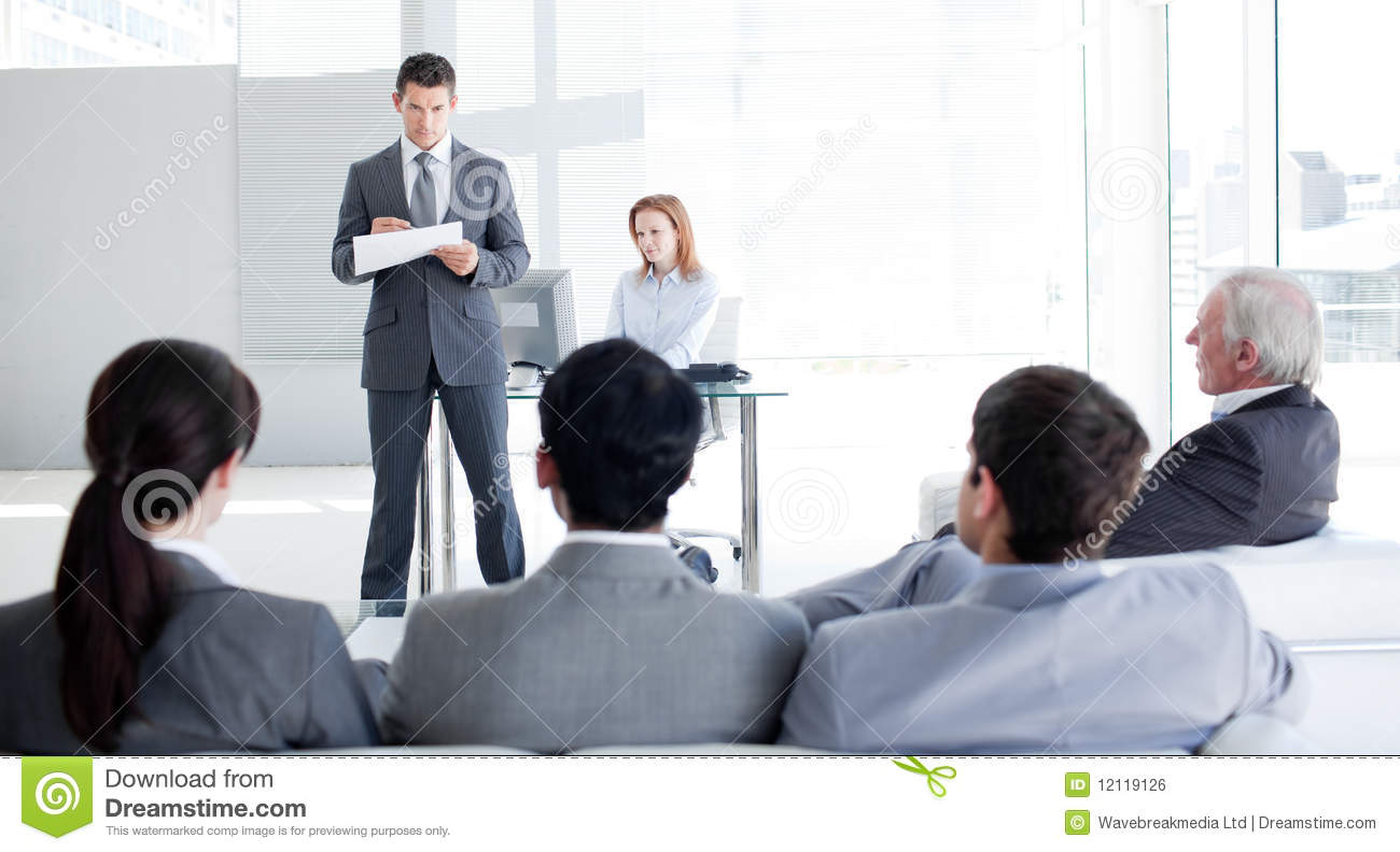 a team leader talking to his colleagues royalty stock image a team leader talking to his colleagues