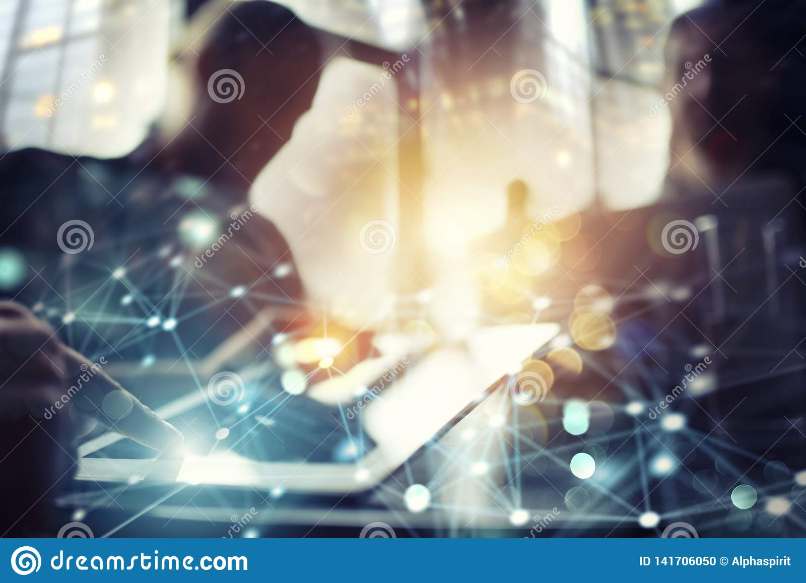 Team of people work together in office with a tablet. Concept of teamwork and partnership. Double exposure