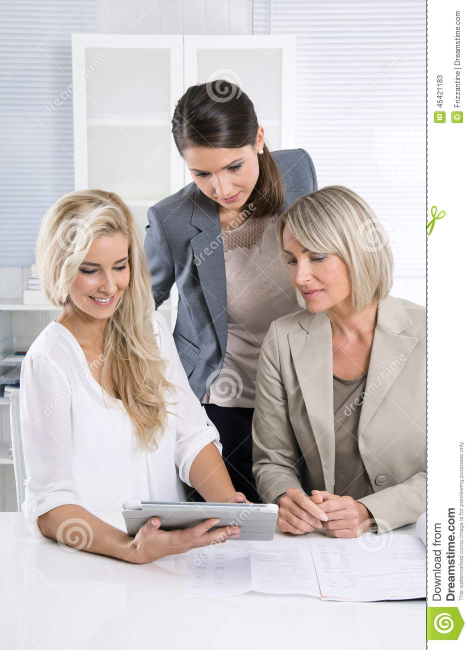Team: Successful business team of woman in the office talking to