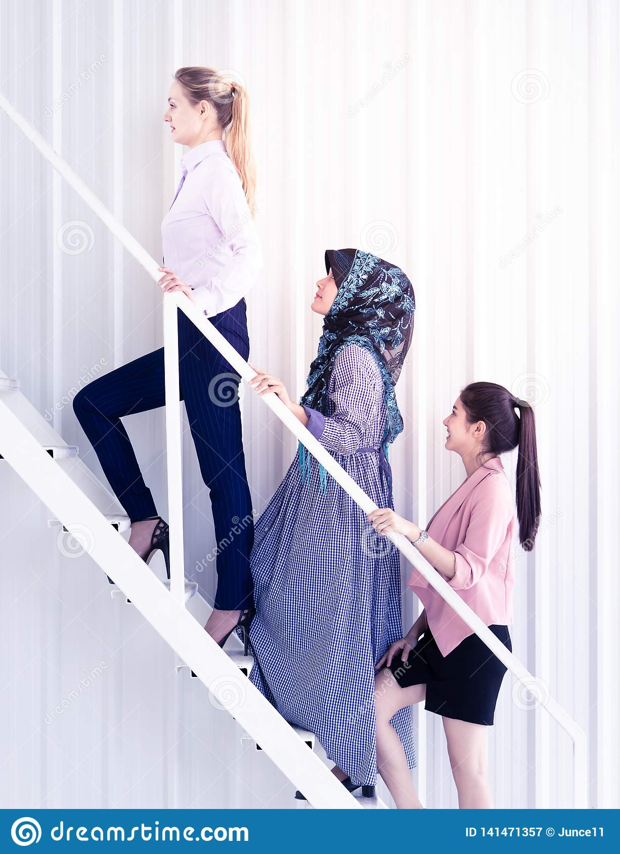 Team up business woman stepping the stair, for woman success concept