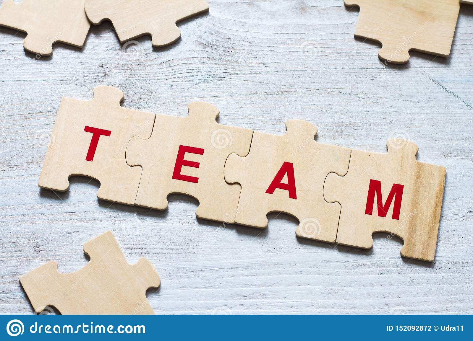 Team word background business concept on puzzle