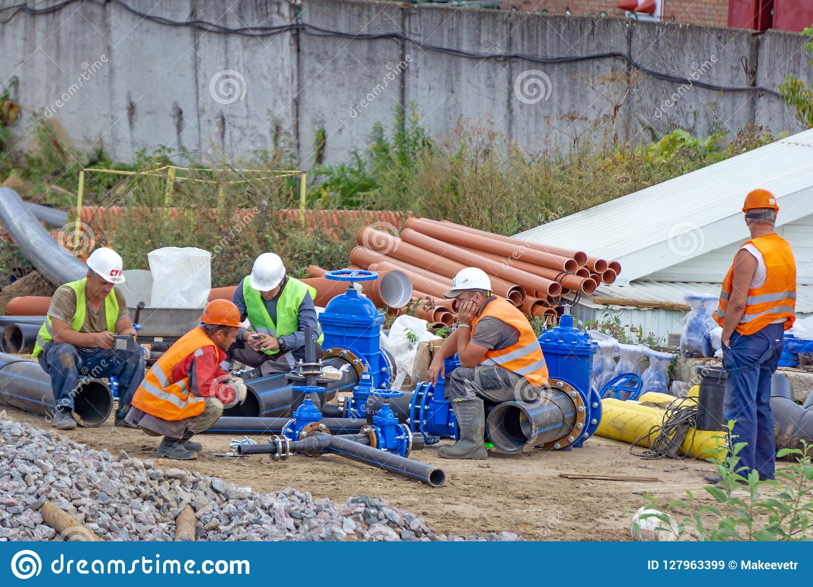 Workers at break and collect pipeline.