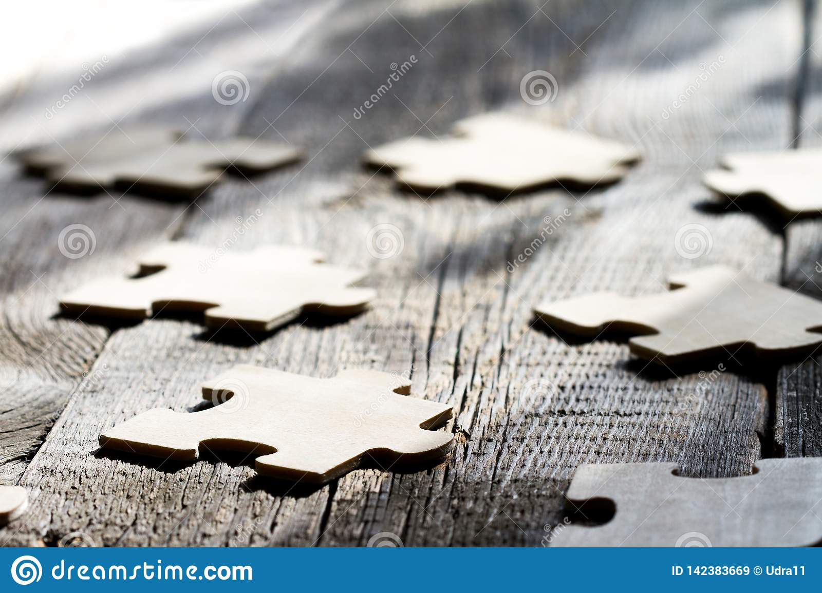 Teamwork in business abstract concept with puzzle on wooden board