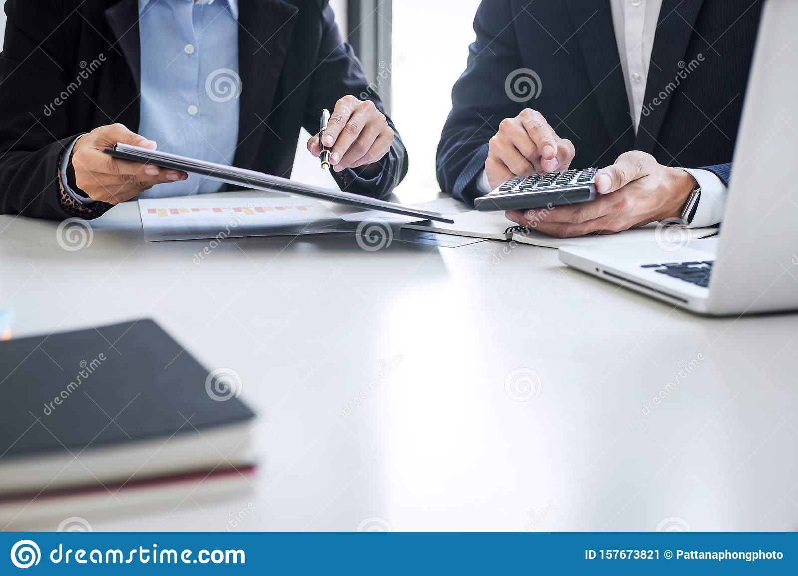 Teamwork of business colleagues, consultation new strategy plan business and market growth on financial document graph report,