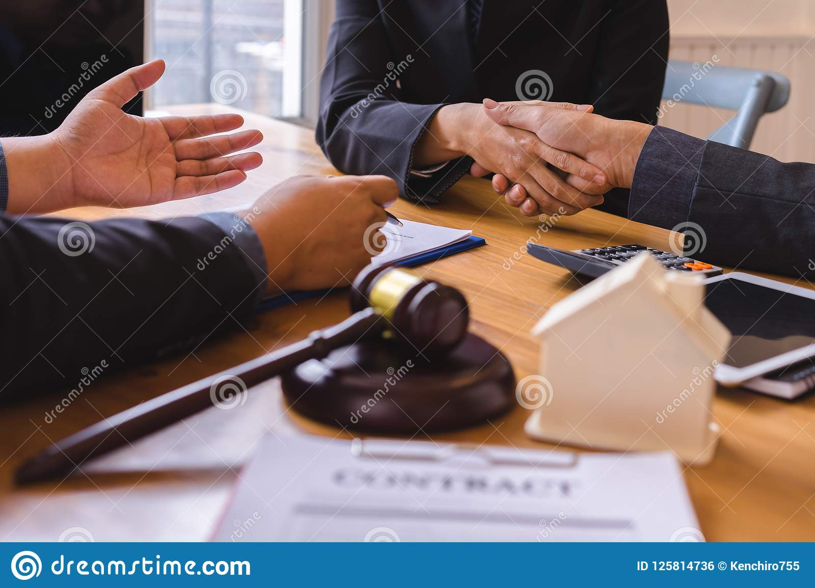 Teamwork of business legal shaking hands meeting after great meeting about Property Law