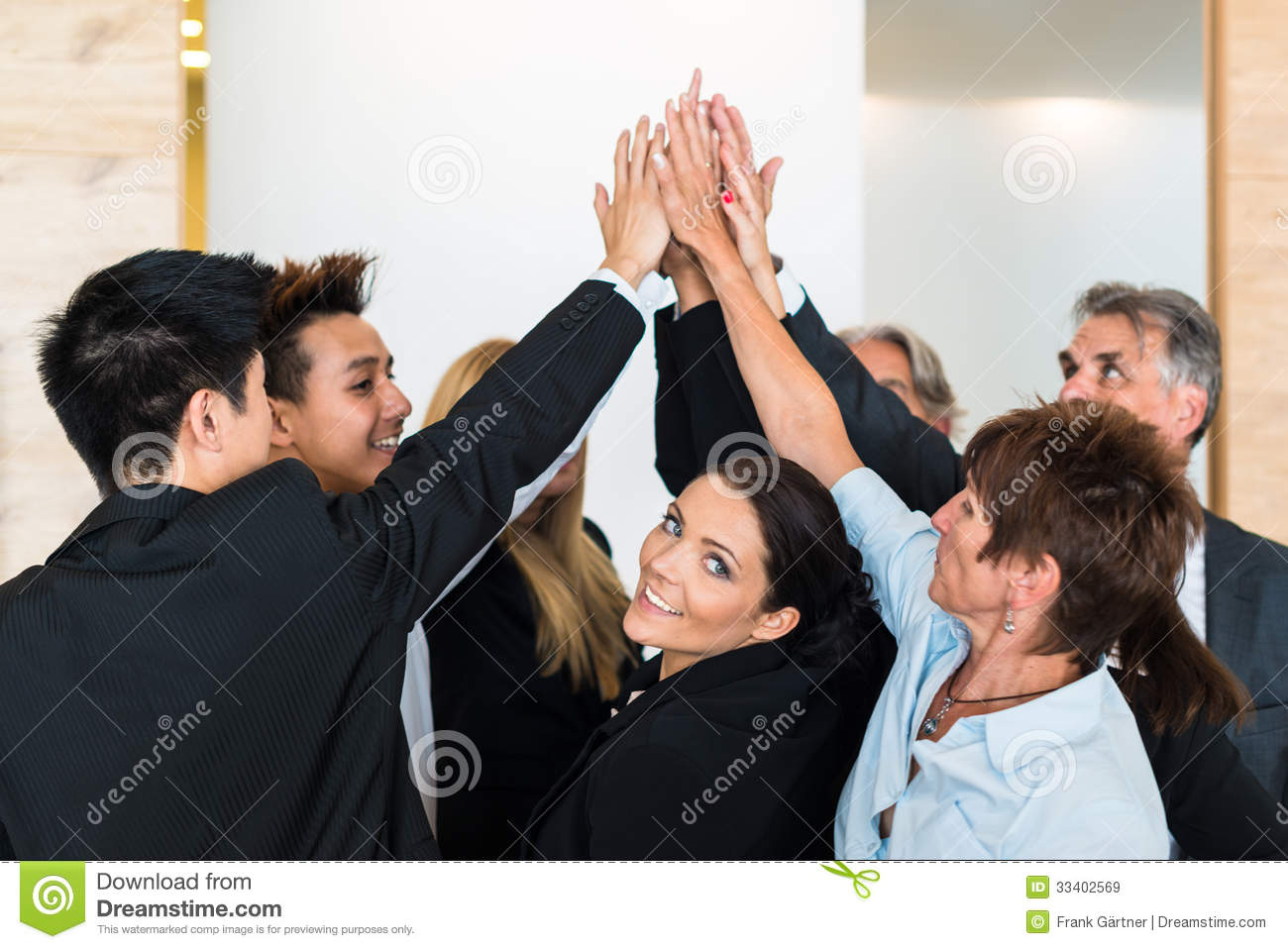Teamwork - business people with joint hands in the