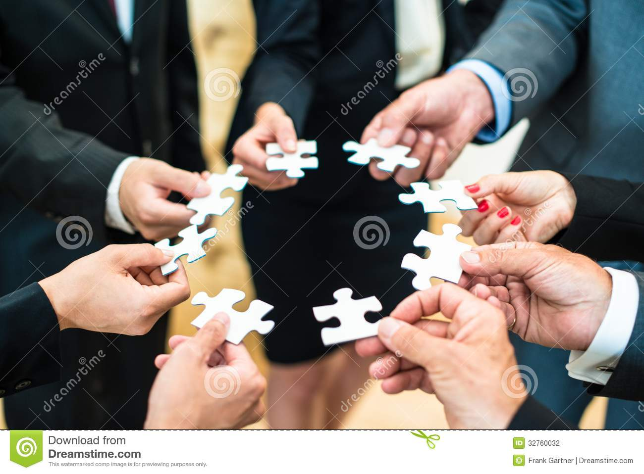 teamwork-business-people-solving-puzzle-