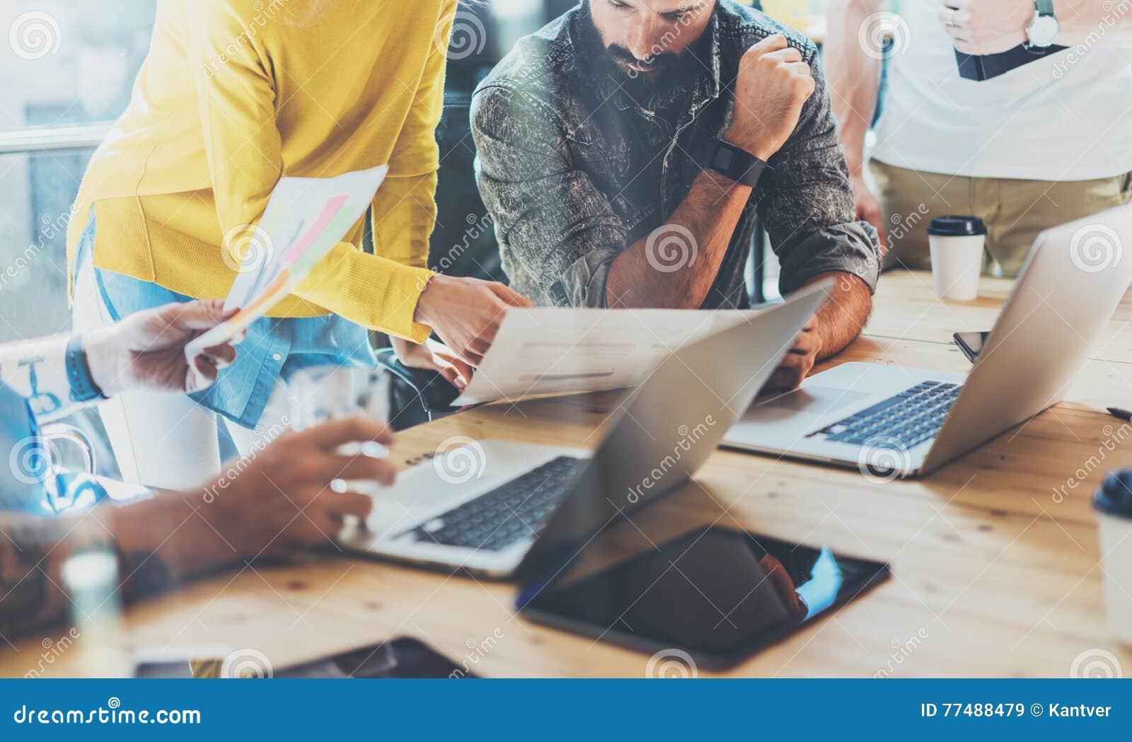 Teamwork Concept.Coworkers Team Brainstorming During Work Process Modern Loft Near Window.Business Startup Project.Woman