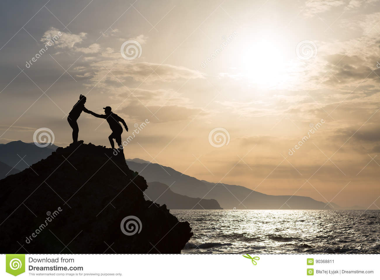 Teamwork couple climbing hiking with helping hand