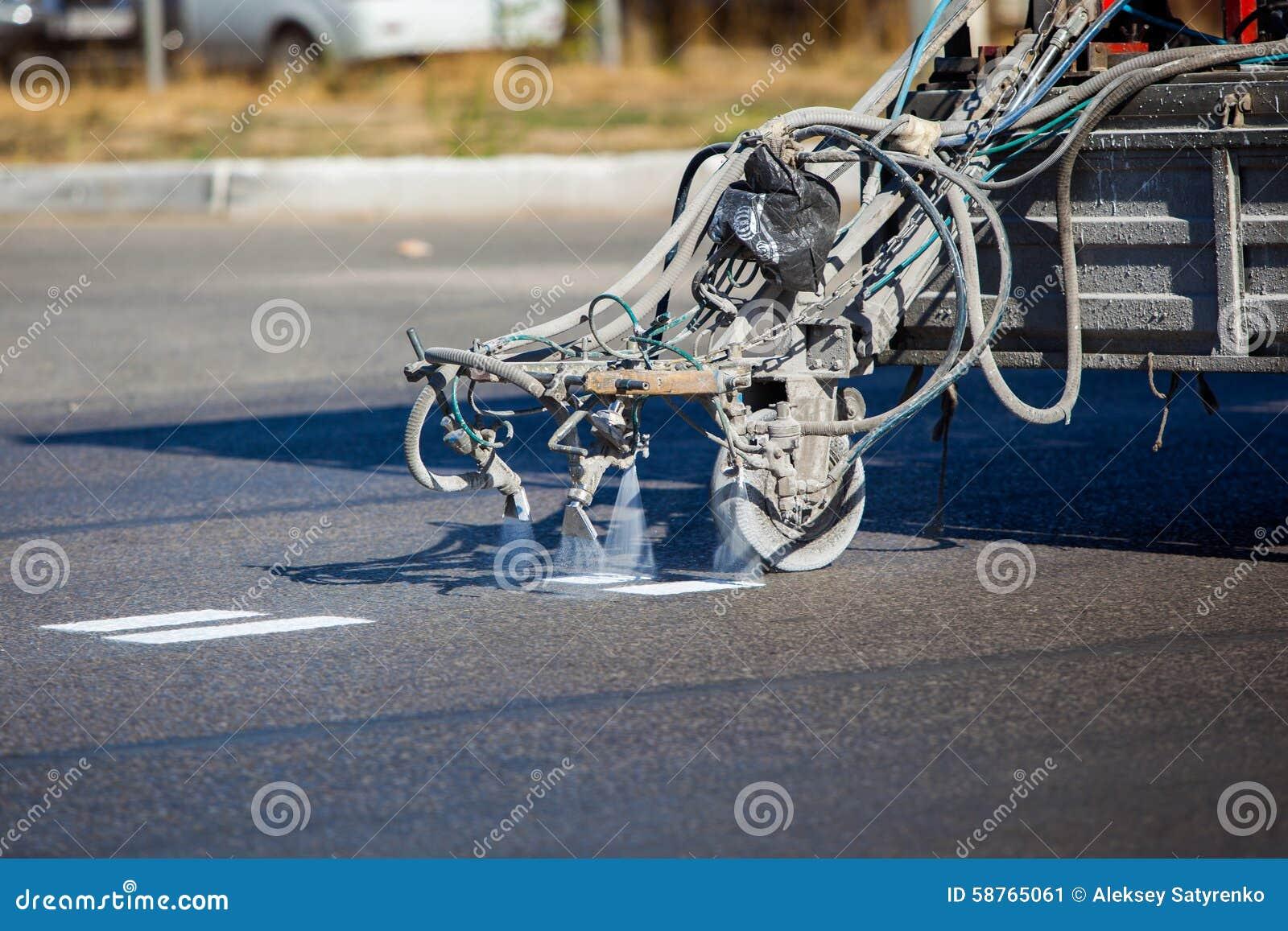 teamwork pavement asphalt road marking paint and stock photo image. Black Bedroom Furniture Sets. Home Design Ideas