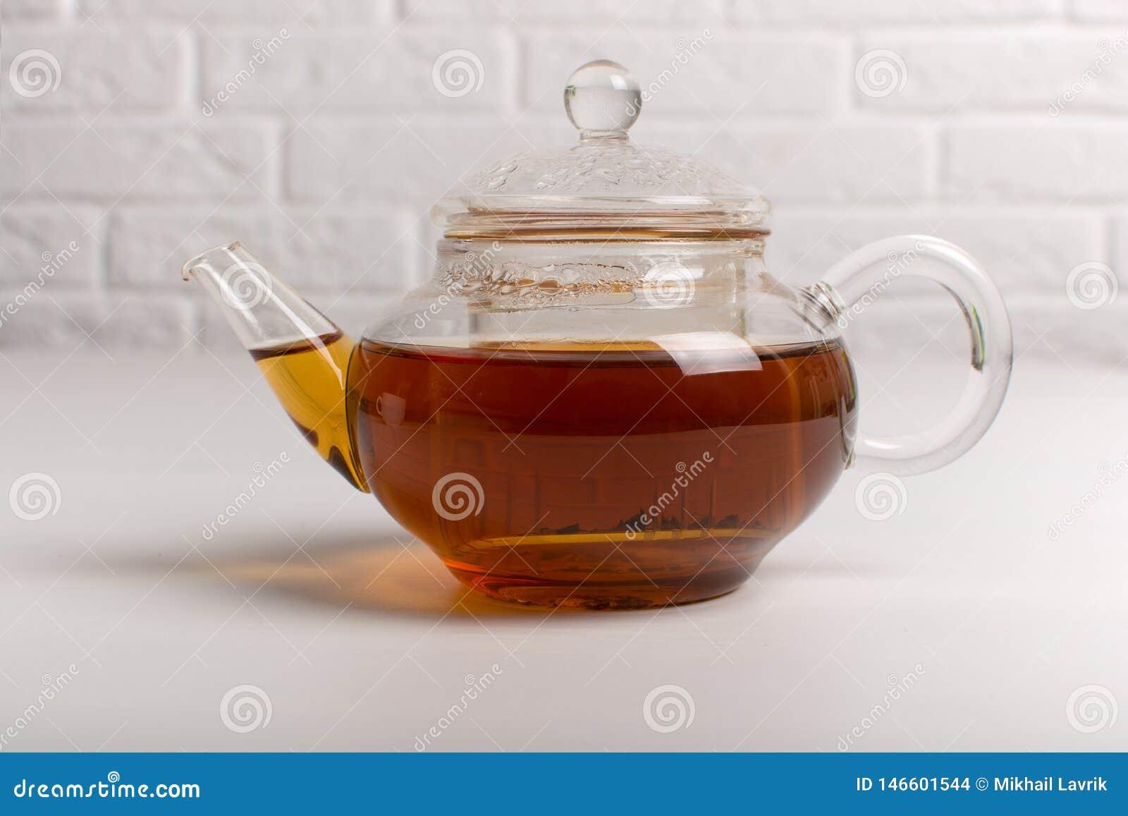 Teapot with black tea.