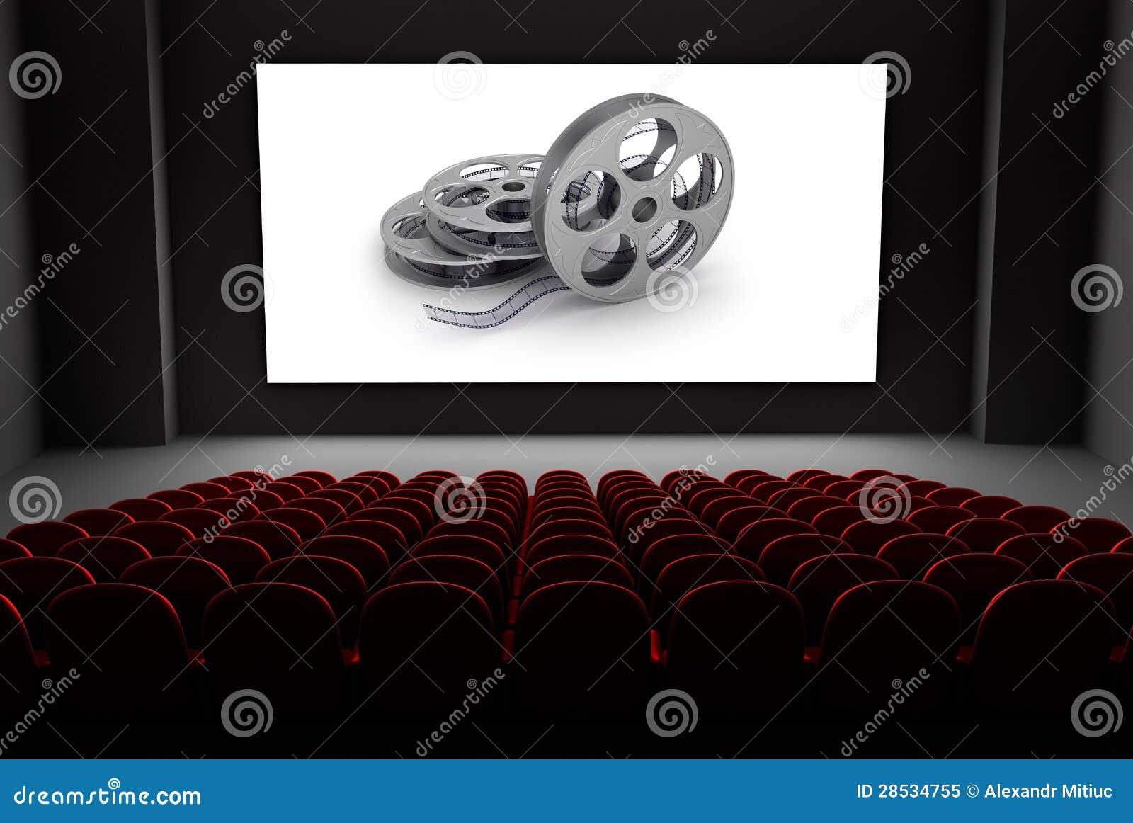 Teatro do cinema com os carretéis do filme na tela.