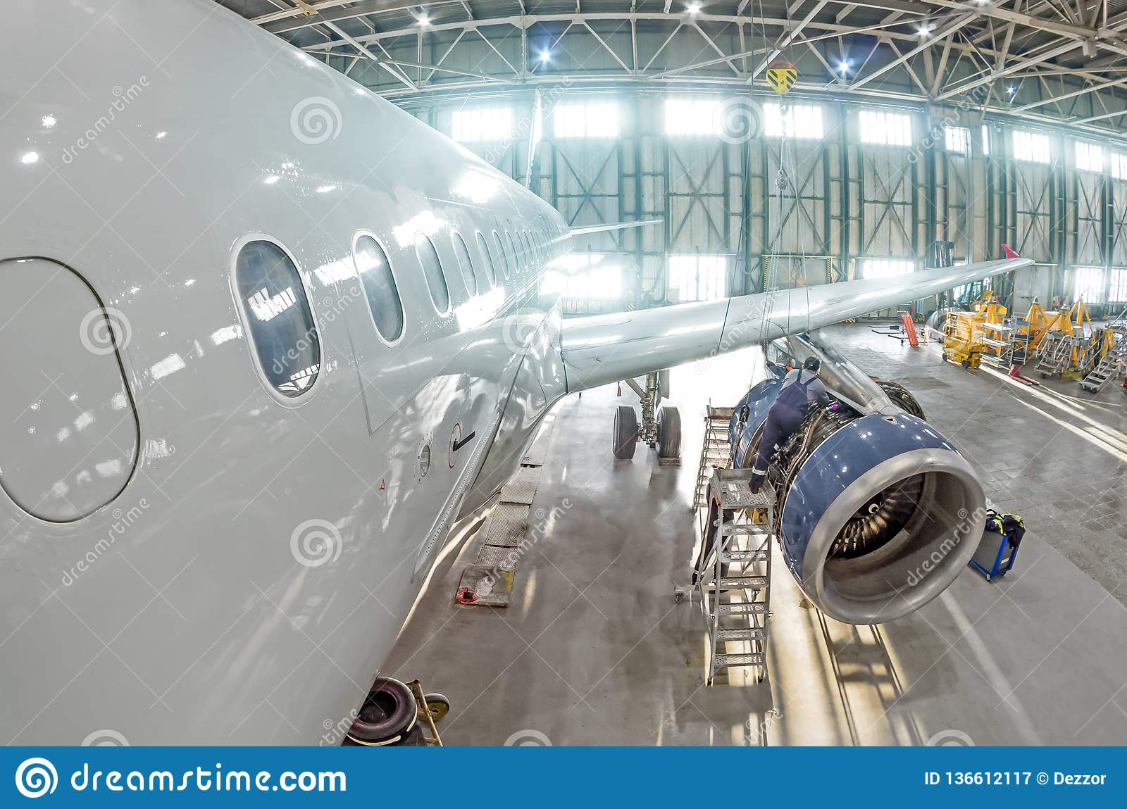 Technical specialists and aircraft technicians install the reverse engine after scheduled service.