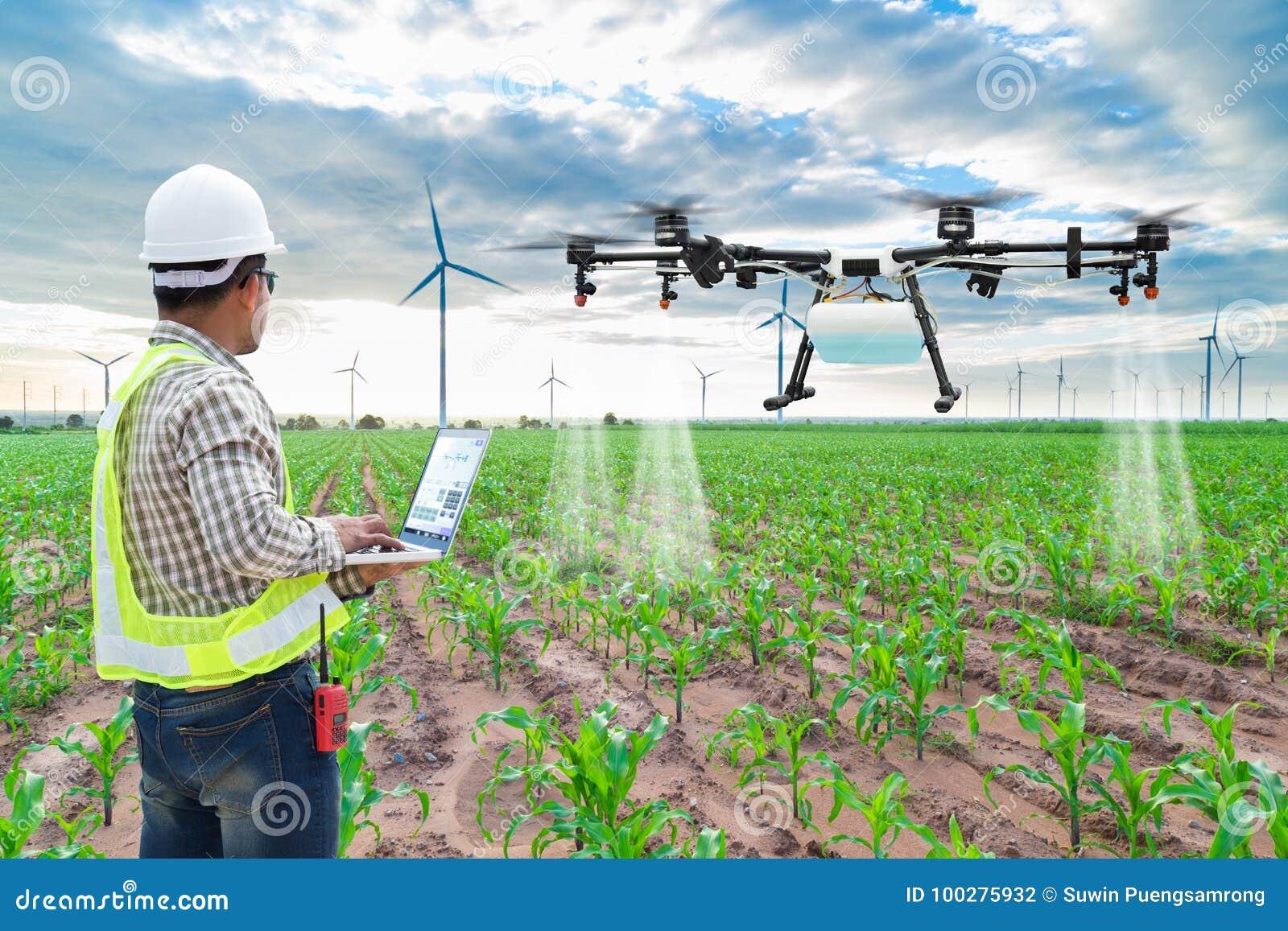 Technician farmer use wifi computer control agriculture drone