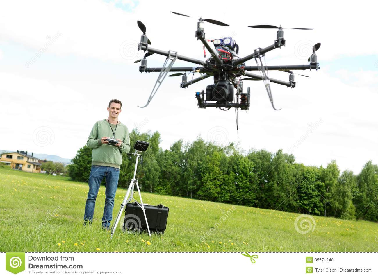 Technician Flying UAV Octocopter in Park