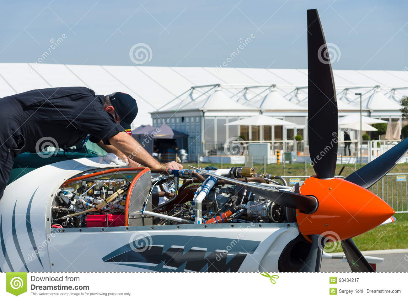 Technician inspects turboprop engine two-seater training and aerobatic low-wing aircraft Grob G 120TP.
