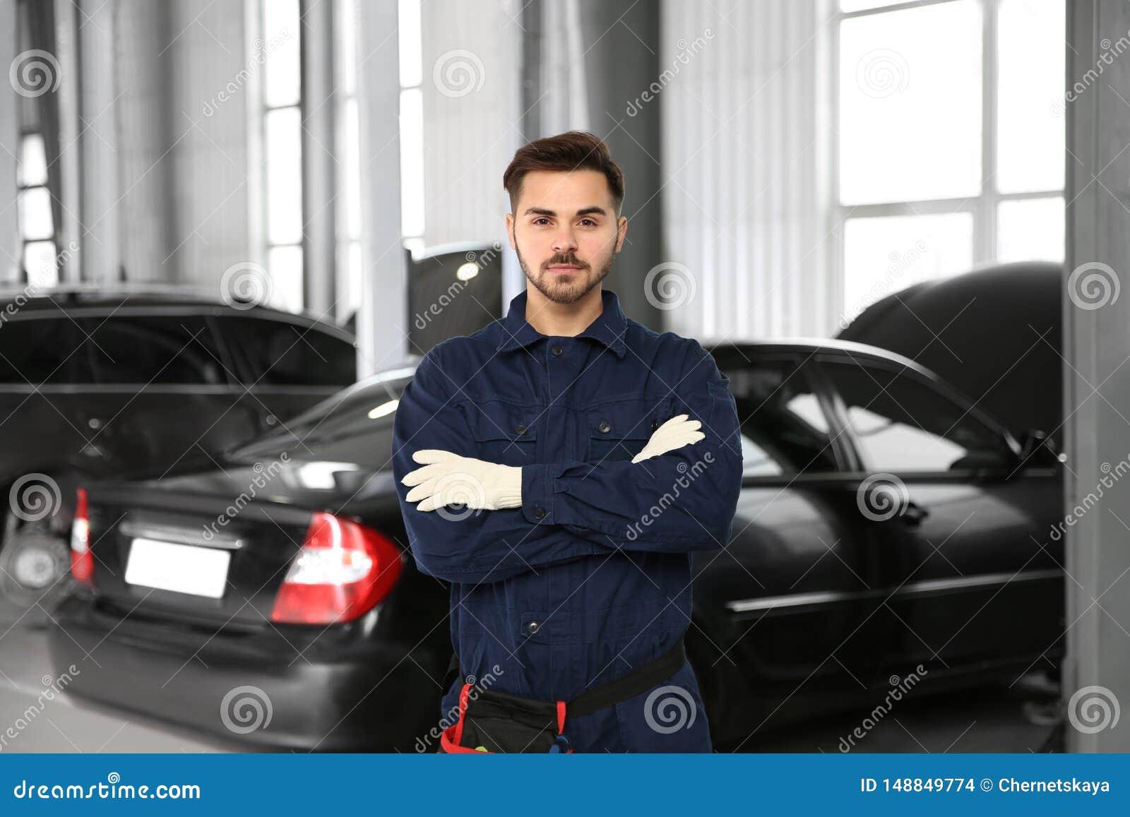 Auto Repair Nearby >> Technician Near Car At Automobile Repair Shop Stock Photo