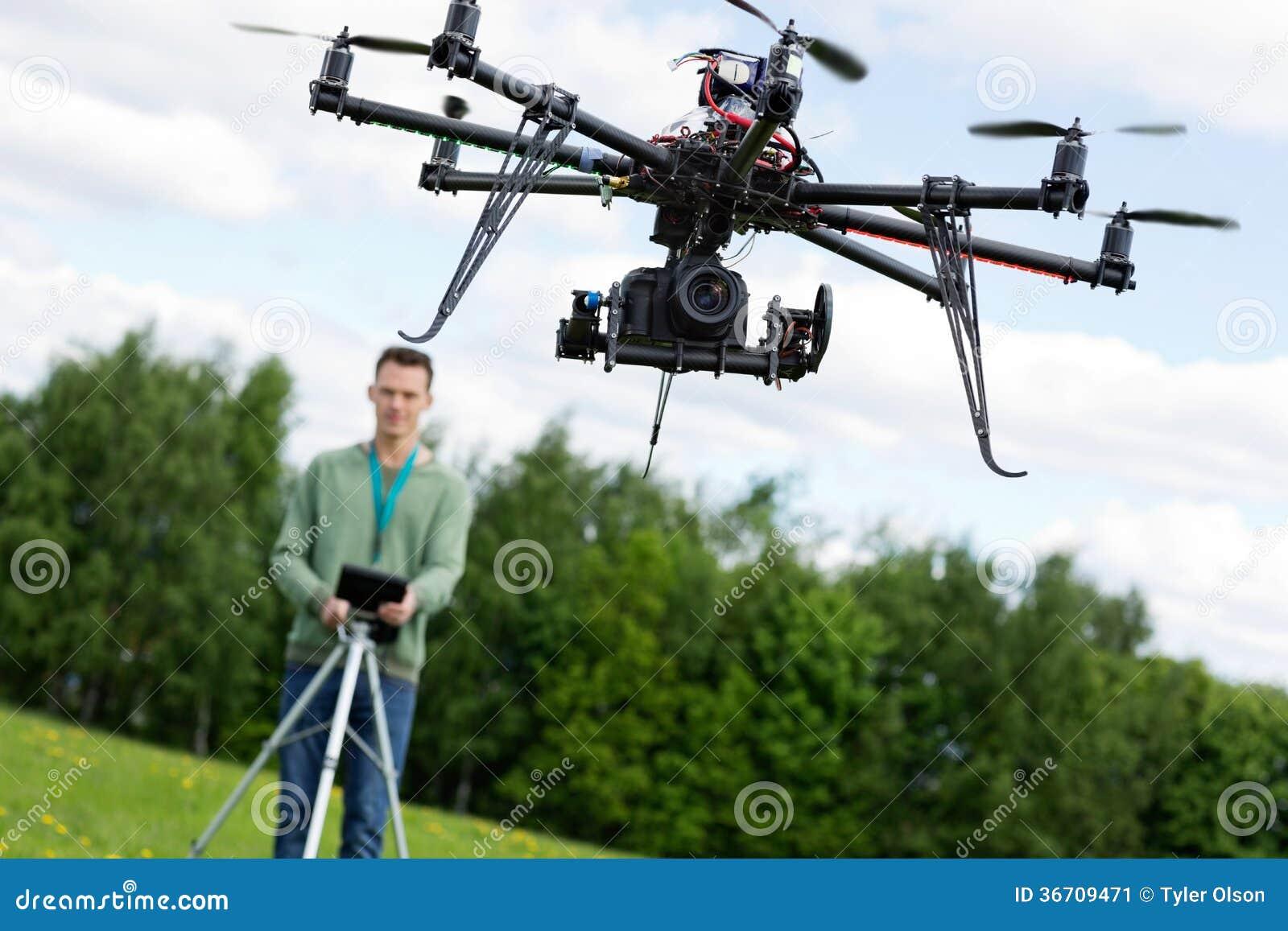 Technician Operating UAV Octocopter