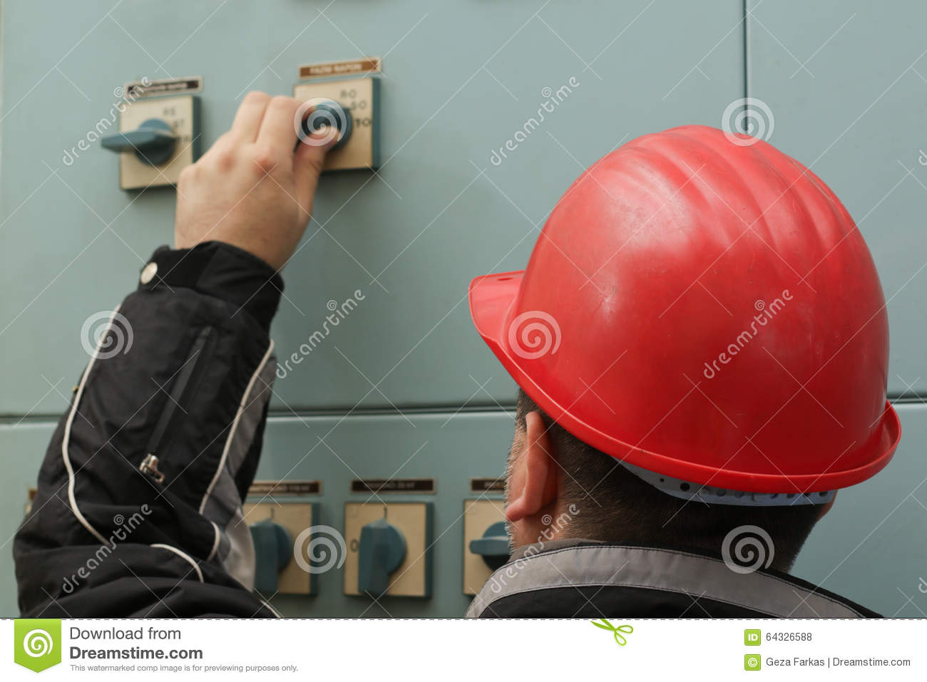 Technician with red helmet turn off the power switch