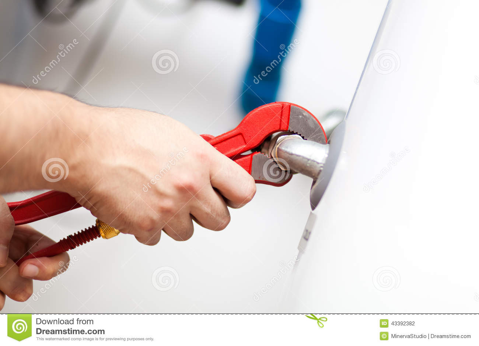 Technician repairing an hot-water heater