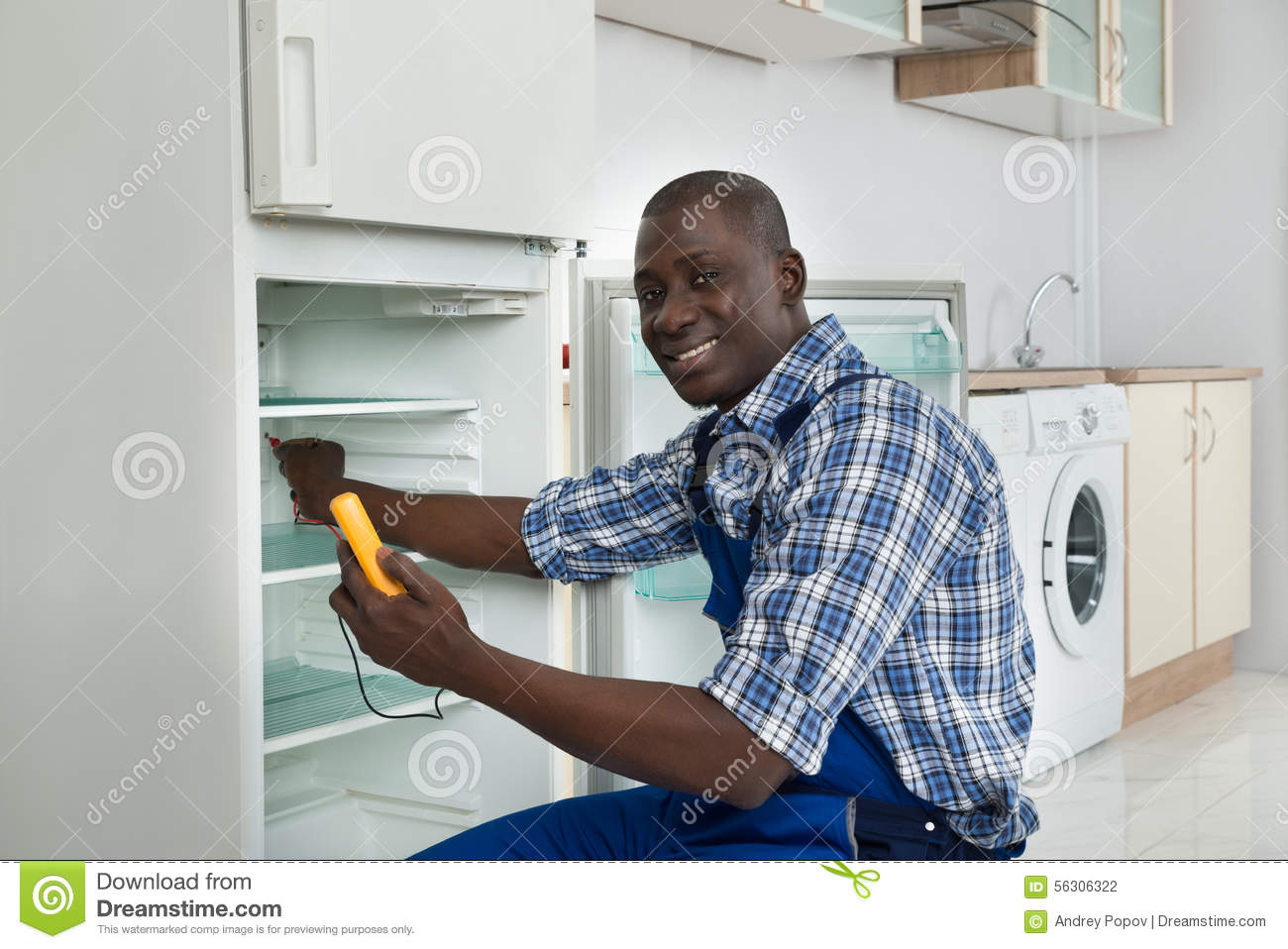Technician repairing refrigerator appliance stock photo for African kitchen