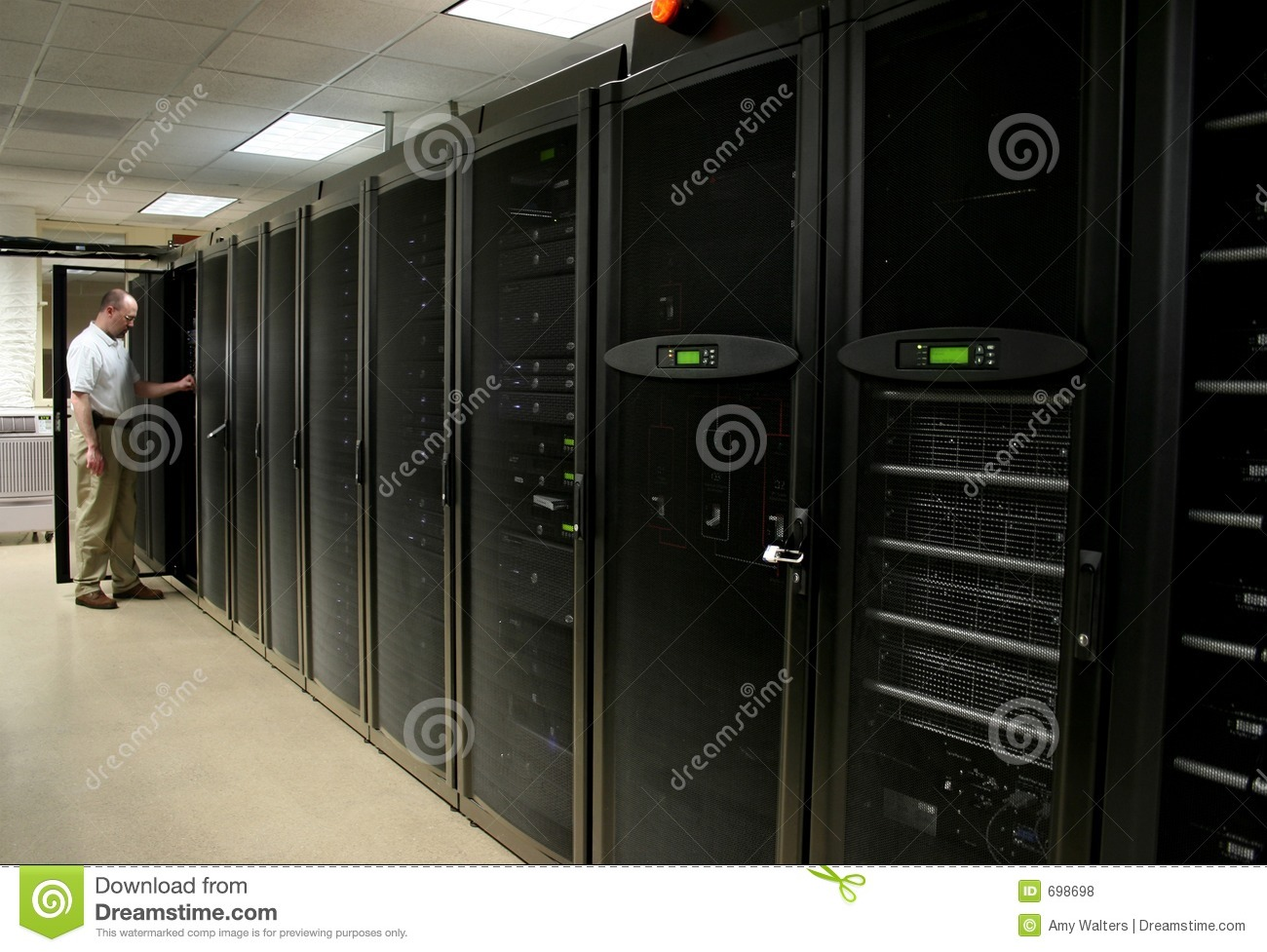 Technician Working In A Server Room Royalty Free Stock