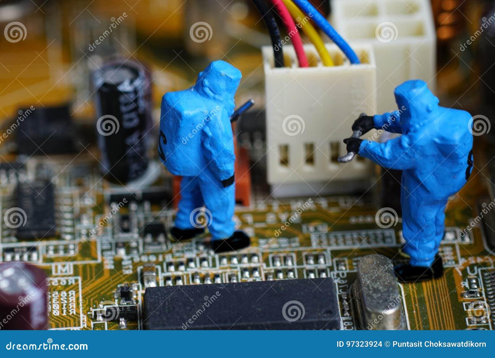 Technicians repair on computer mainboard.