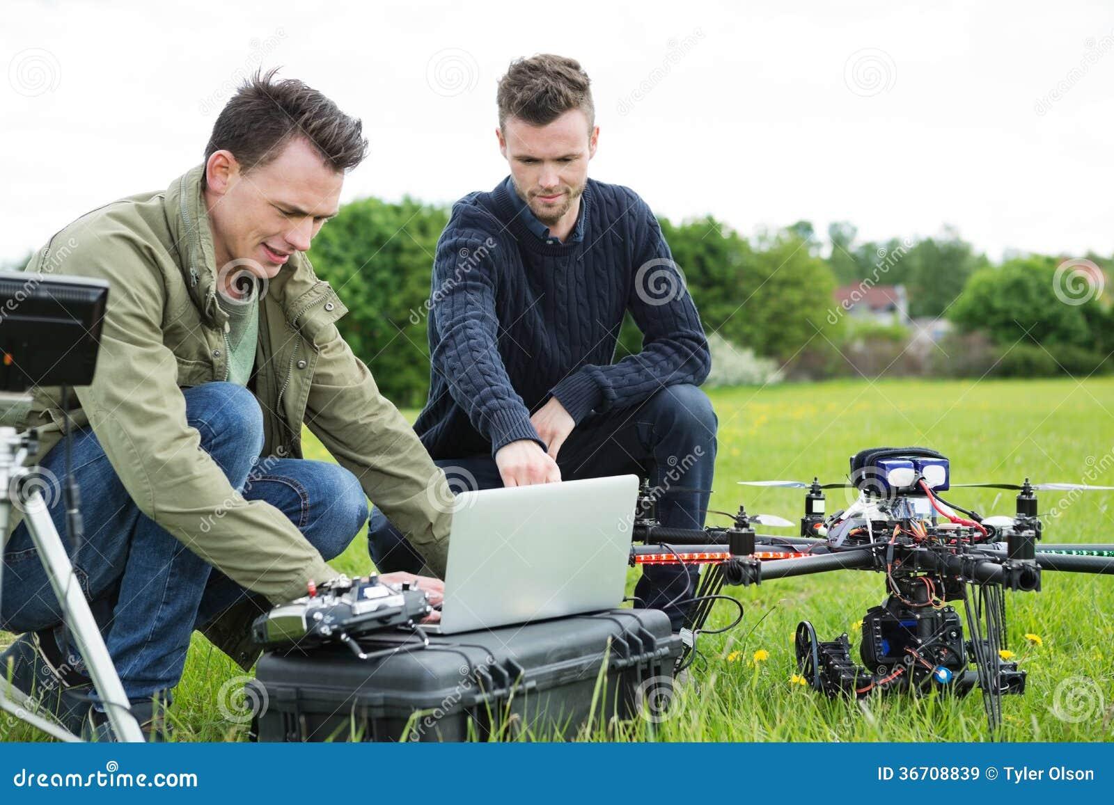 Technicians Using Laptop By UAV Drone