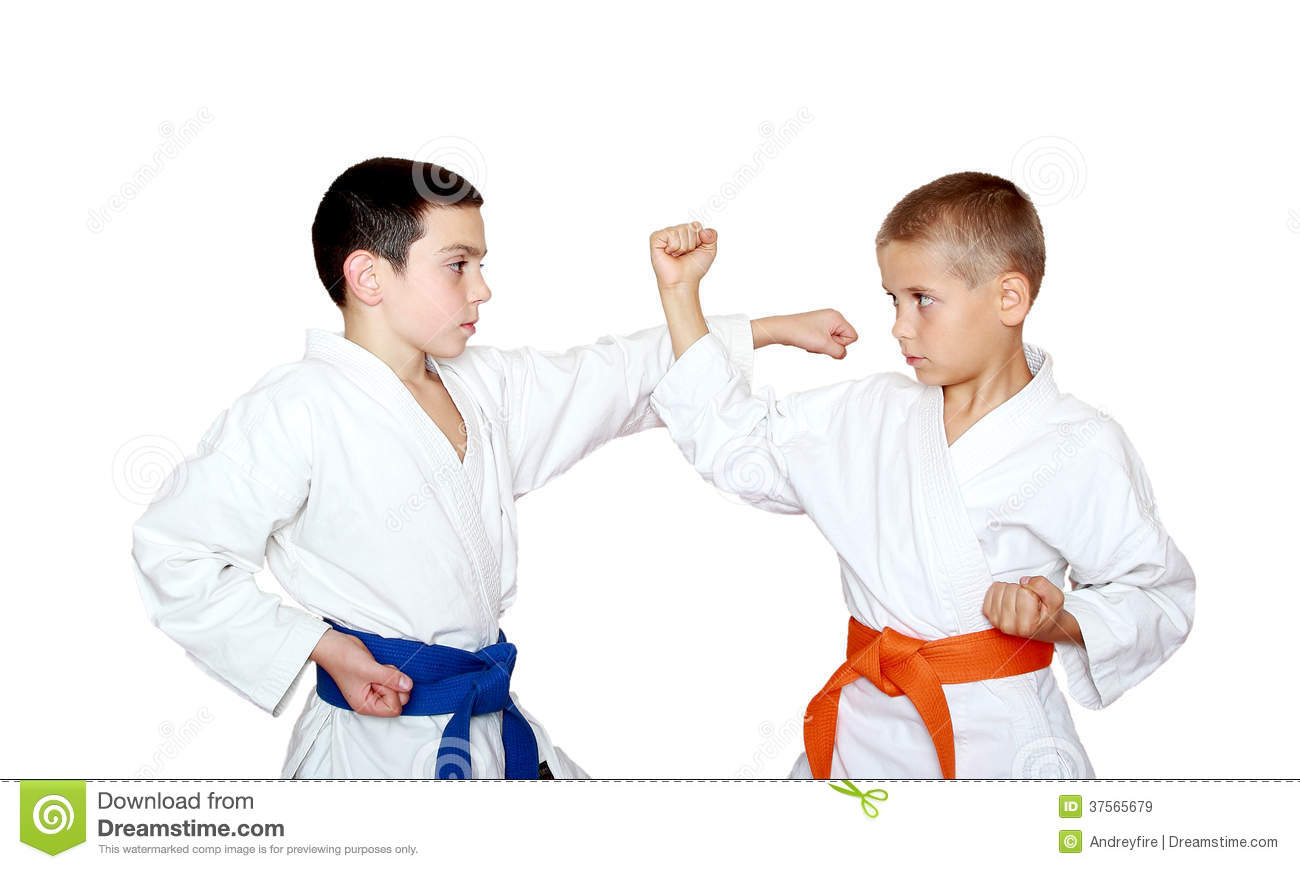 Boys Sportsmen With Orange And Blue Belt Training Paired