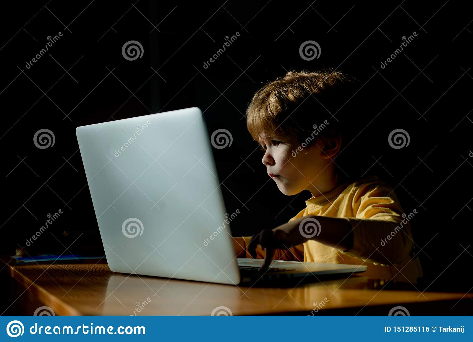 Technology. Computer user. The child looks with passion at the computer screen. Monitor, interest information for