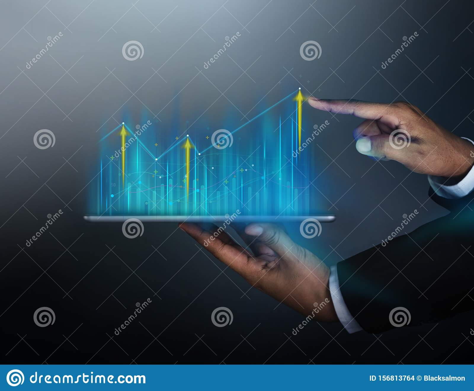 Technology, High Profit, Stock Market, Business Growth, Strategy Planing concept. Businessman in Suit Touching High Graphs and