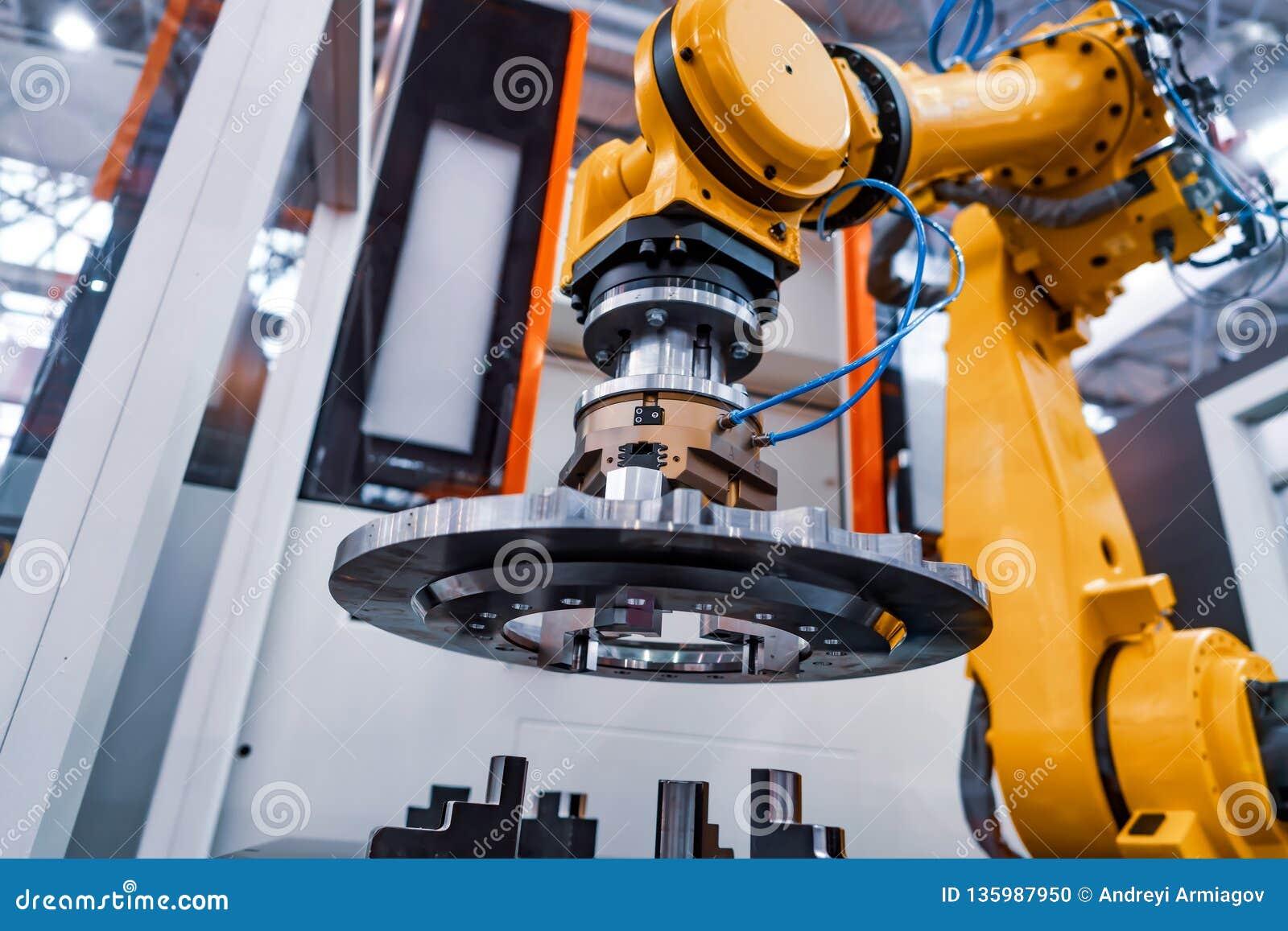 Tecnologia industriale moderna del braccio robot Cellula automatizzata di produzione