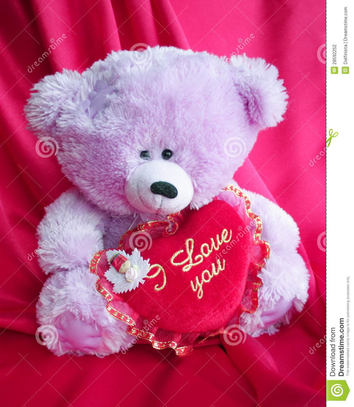 Teddy bear with red lo...