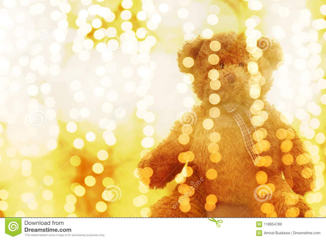teddy bear doll in lighting line bokeh gold bright for christmas or happy new year background