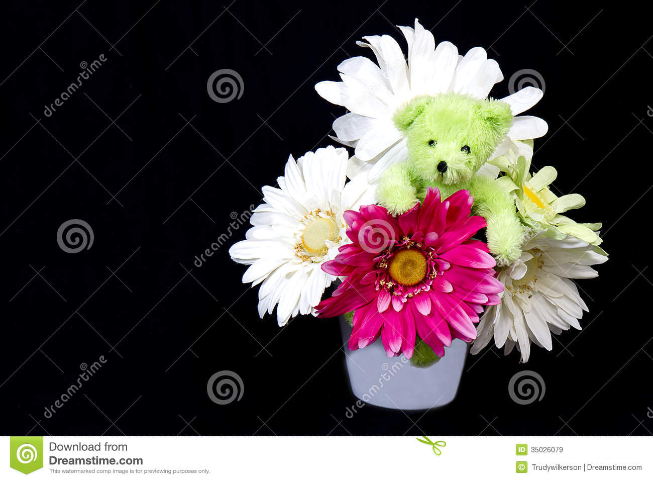 Teddy bear flowers stock photos royalty free pictures teddy bear in flowers cute green teddy bear snuggled in a bouquet of faux paper izmirmasajfo
