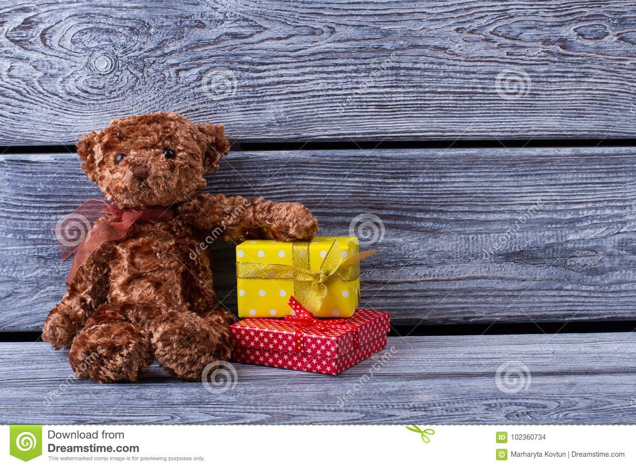 Teddy Bear And Gift Boxes On Gray Wooden Background Perfect Present For A Crush Birthday St Valentines Day Or Christmas