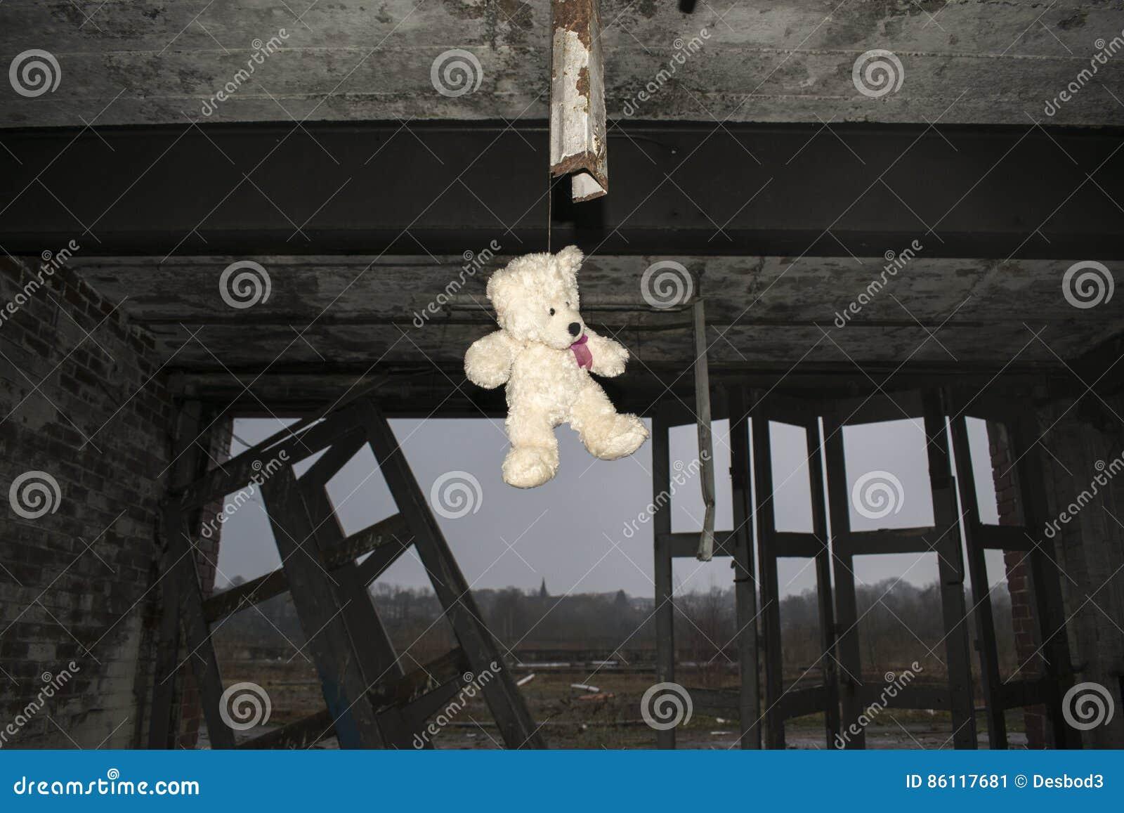 Teddy Bear Hanging In Derelict Verlaten Fie Station Building