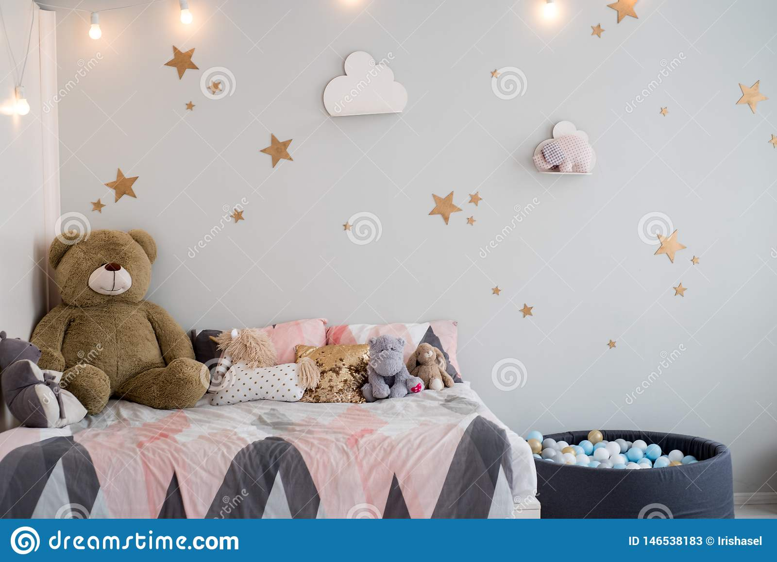 Teddy Bear Between Paper Bags And Wooden Chairs In Child S Room With Pastel Lamp Above Table Stock Image Image Of Bedroom Bear 146538183