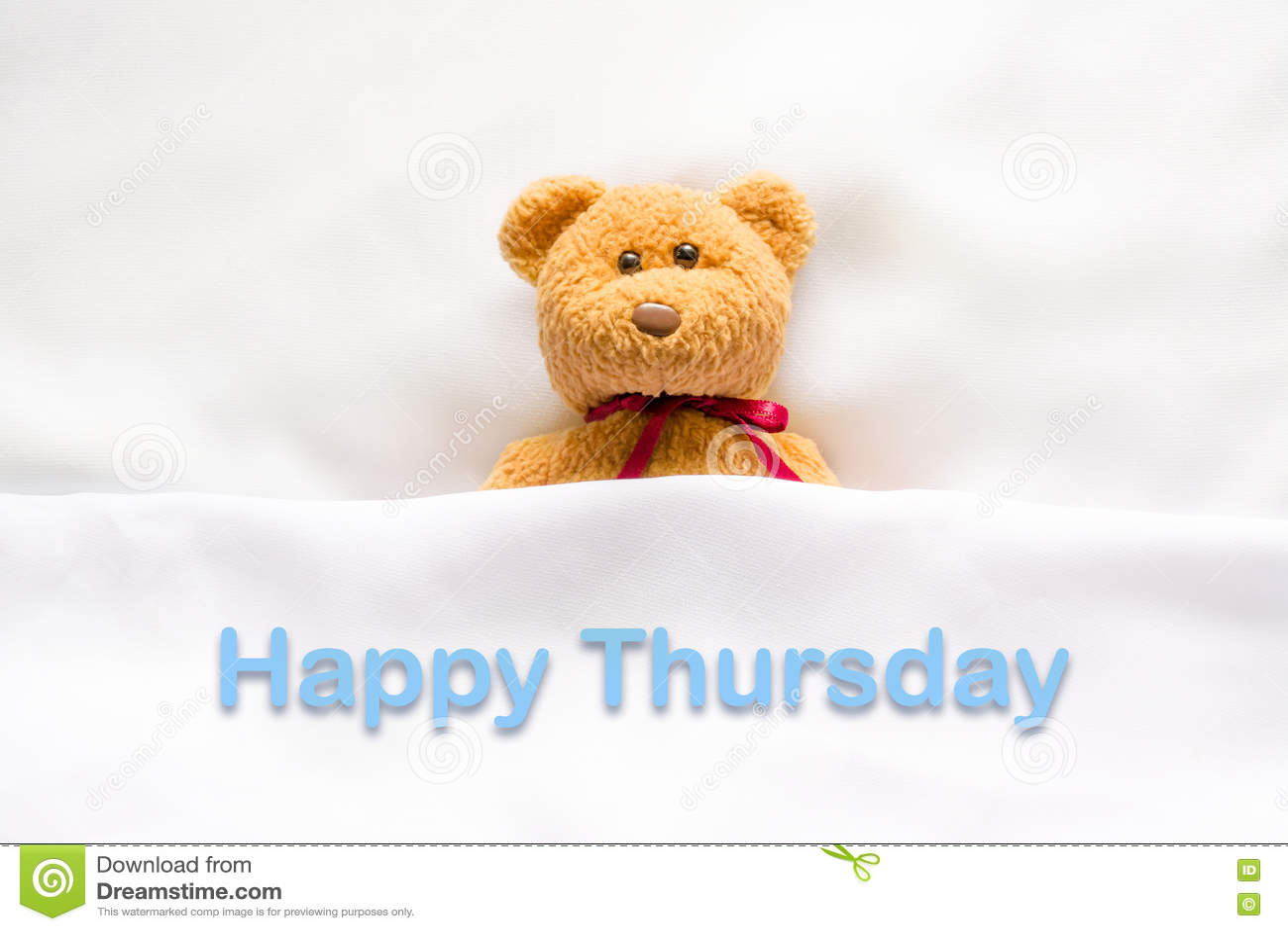 Teddy Bear se situant dans le lit blanc avec le message jeudi heureux